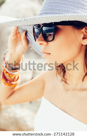 Young summer sexy woman wearing hat  and sunglasses. Outdoors lifestyle portrait - stock photo
