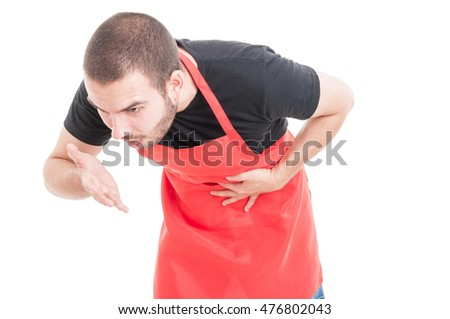 Young supermarket seller feeling nausea and having stomachache on white background