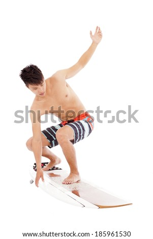 young  surfer make a  surfing pose - stock photo