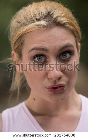 Young surprised woman - stock photo