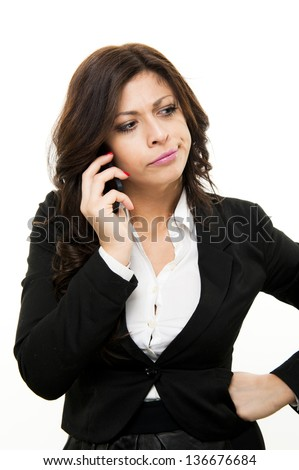 young suspicious business woman talking on the phone