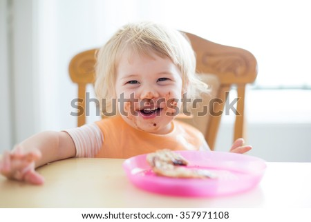 Young sweet child with dirty mouth - stock photo