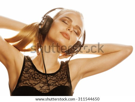 young sweet talented teenage girl in headphones singing isolated close up - stock photo