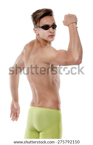 Young swimmer Caucasian man with his hand up showing muscles - stock photo