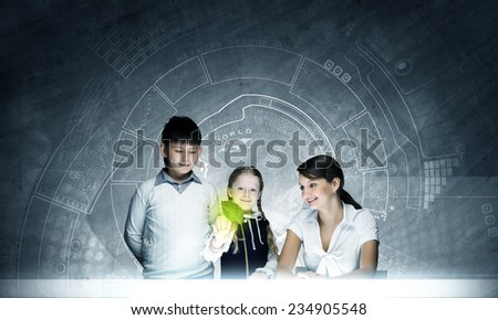 Young teacher and school children at botany lesson - stock photo