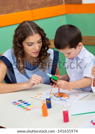 Young teacher student in art class - stock photo
