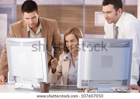 Young team learning computer graphic design at further education. - stock photo