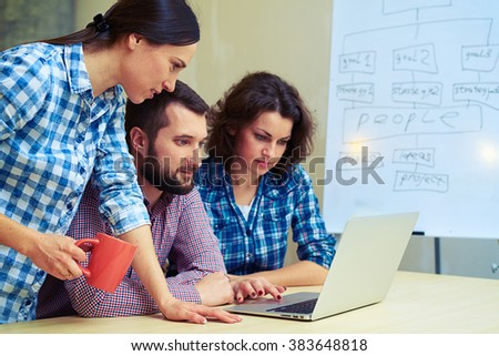 young team mates working in the office - stock photo