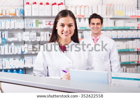 Young team of pharmaceutist and technician working at a chemist shop