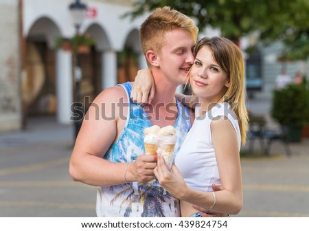 young teen couple eating ice cream cones
