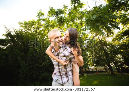 young teen couple in love having fun and enjoying the beautiful nature in park