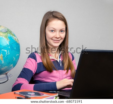 Young Teen Girl Doing Homework at Computer - stock photo