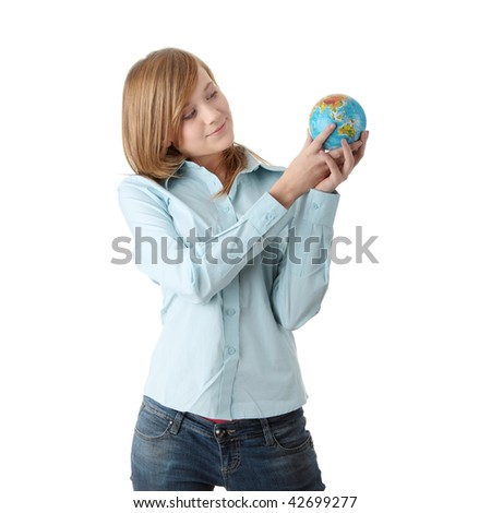 Young teen girl holding globe, isolated on white background - stock photo