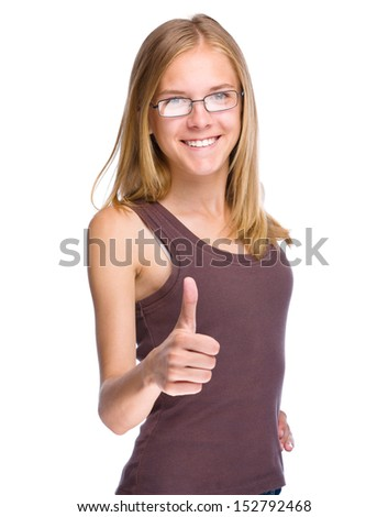 Young teen girl is showing thumb up gesture, isolated over white - stock photo