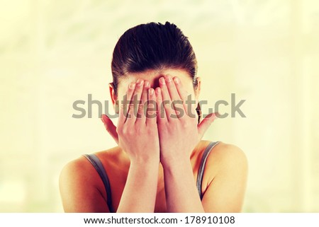 Young teen woman covering her eyes  - stock photo
