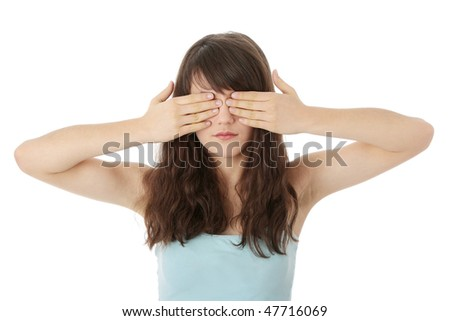 Young teen woman covering her eyes isolated on white background - stock photo