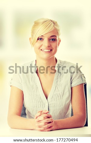 Young teen woman sitting behind the desk  - stock photo