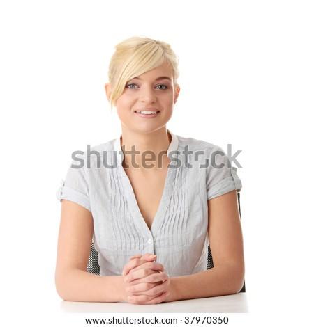 Teen Sitting Behind The Teachers Desk
