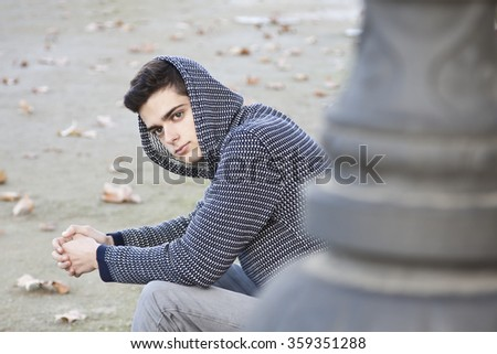 young teenage boy in the park outdoors