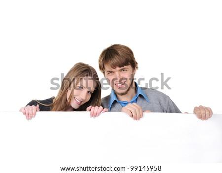 Young teenage couple holding billboard - stock photo