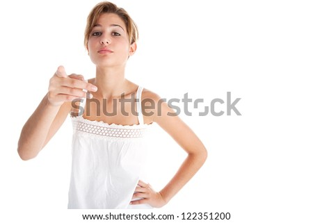 Young teenage girl having a conversation with the camera and pointing at it with her hand while isolated on a white background. - stock photo