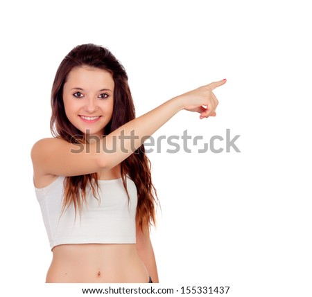Young teenage girl pointing at something with his index finger