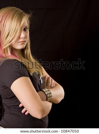 Young teenage girl posing on black background - stock photo