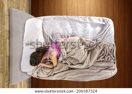 young teenage girl scared alone in the bedroom - stock photo