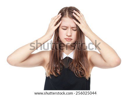 Young teenage girl with headache isolated on white background - stock photo