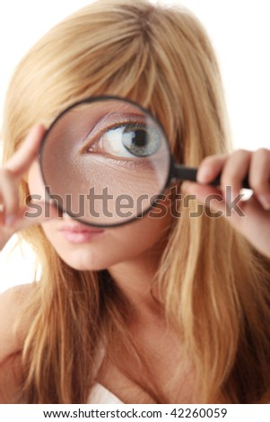 Young teenage girl with magnifier / searching and exploring concept