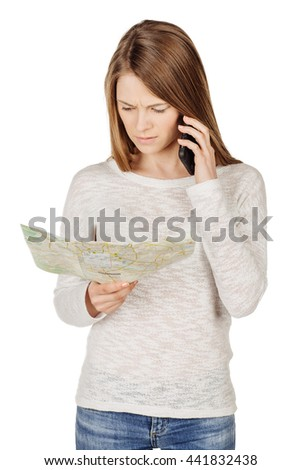 young teenage girl with smartphone and paper map. emotions, technology,travel and people concept.