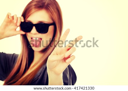Young teenage woman wearing sunglasses - stock photo