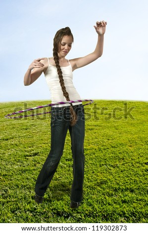 Young teenage woman with a hula hoop