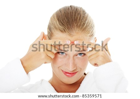 Young teenage woman with pimple on her face .Isolated on white background. - stock photo