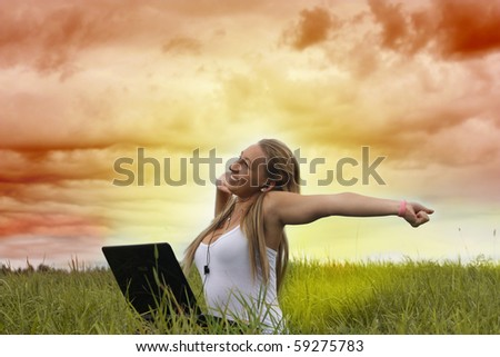 Young  teenager girl  in natural environment with laptop.
