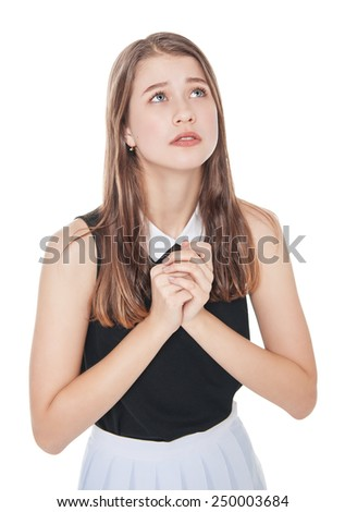 Young teenager girl praying isolated on white background - stock photo