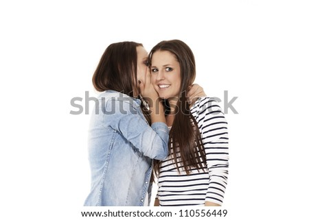 young teenager whispering chit-chat to her laughing friend on white background