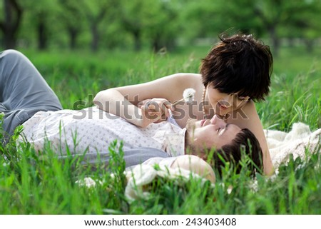 Young tenderness couple relax in blossom garden