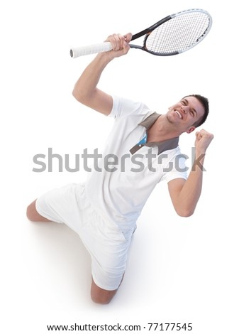 Young tennis player happy for victory, kneeling, looking up to the sky.? - stock photo