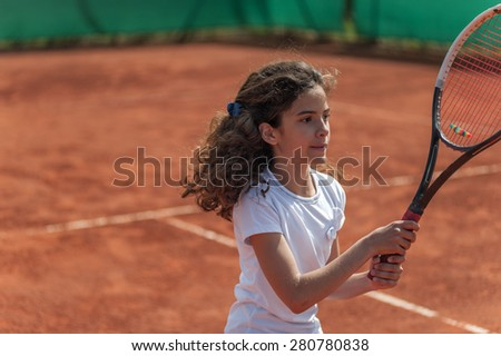 young tennis player playing tennis - stock photo