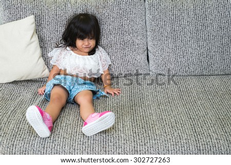 Young Thai girl playing in living room