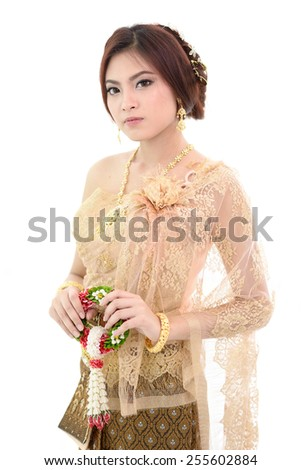 Young Thai lady in traditional costume holding garland. - stock photo