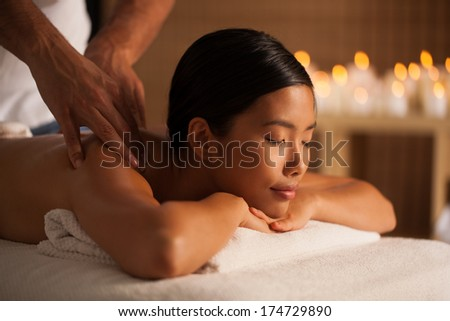 Young Thai woman enjoying a relaxing back massage.