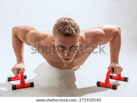 Young the man trains - stock photo