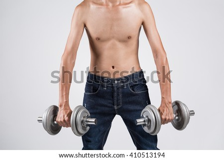 Young thin asian sportman working out with gym and ligting weights, isolated on background - stock photo