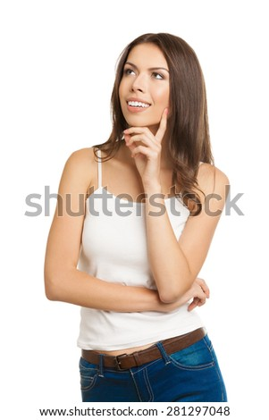 Young thinking or planning and cheerful smiling pensive brunette woman, looking up, in tank top casual smart clothing, isolated over white background - stock photo