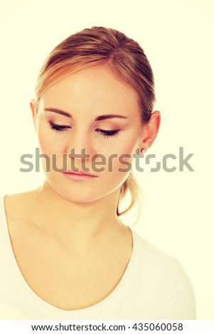 Young thoughtful and sad woman - stock photo