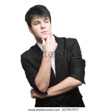 young thoughtful caucasian businessman in black suit isolated on white