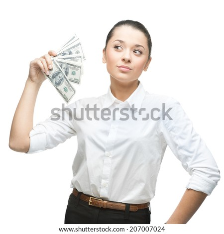 young thoughtful caucasian businesswoman in white blouse holding money isolated on white background