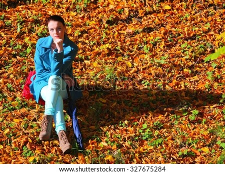Young  thoughtful pensive woman outdoor, sad unhappy girl thinking in the autumn park. Loneliness stress depression. - stock photo